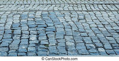Tracks in Cobblestones