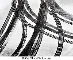 Tracks of car tires in thin layer of first snow