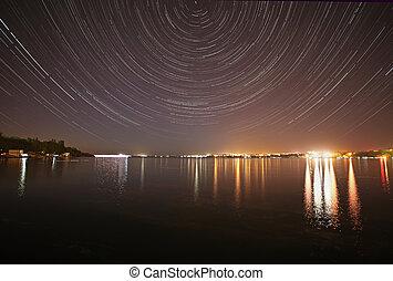 tracks of stars in night sky