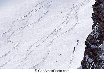 Tracks on a mountain Slope, freeride in deep snow - Tracks...