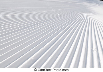 tracks on ski slopes at beautiful sunny  winter day