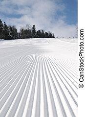 tracks on ski slopes at beautiful sunny winter day - tracks...