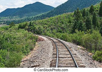 Tracks - Train tracks curving along a mountain pass near La...