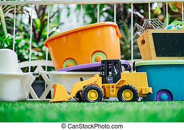 Tracktor toy car with toy boxes in the garden