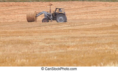Tractor and Hay Bale
