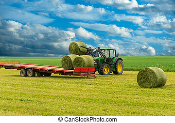 Tractor and hay bales - Tractor and trailer with hay bales...