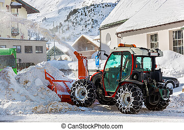 Tractor blower cleaning snow in street