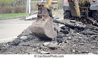 Tractor bucket breaks asphalt - Old tractor bucket breaking...