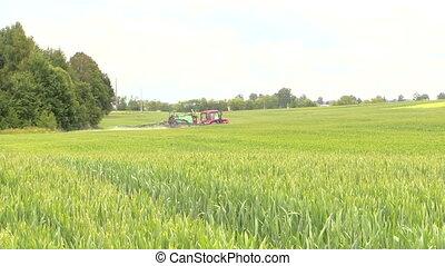"""tractor crop sprayer - """"farmer spraying crop field at summer..."""
