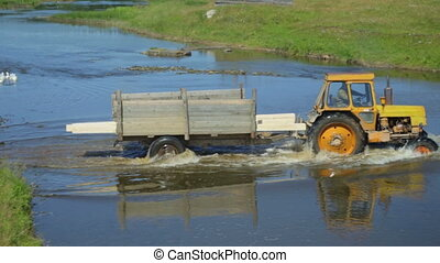 Tractor crossing a river