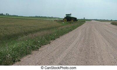 Tractor Crossing Dirt Road