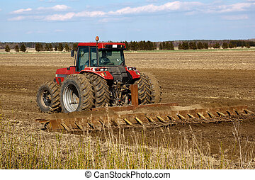 Tractor cultivated field in early spring