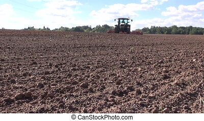 tractor cultivating farm field