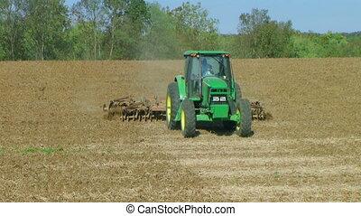 Tractor Discing Field 02 - Tractor discing field with disc...