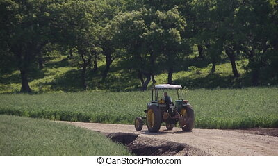 tractor during summertime - Shot of tractor during...