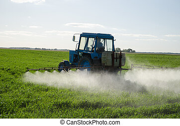 Tractor fertilize field pesticide and insecticide - Tractor...