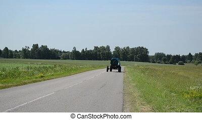 tractor field straw bale