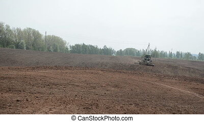 tractor harrow field - heavy agricultural caterpillar...