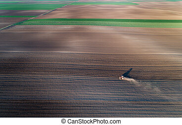 Tractor harrowing soil - Aerial view of tractor harrowing ...