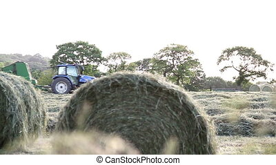 Tractor harvesting a field