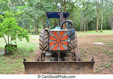 Tractor in a field, agricultural sc