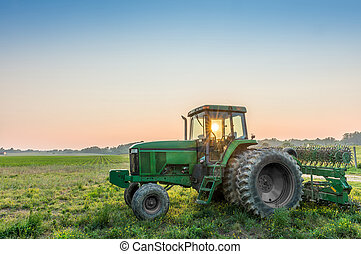 Tractor in a field on a Maryland Farm near sunset