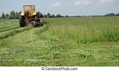 tractor in meadow - tractor makes sharp turn in the meadow...