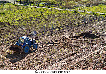 tractor in plowed field, agricultural land, agriculture fields for sowing