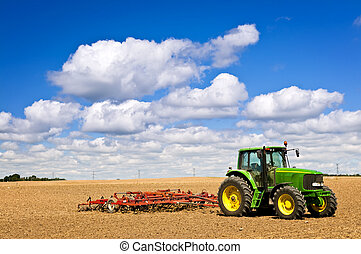Tractor in plowed field - Small scale farming with tractor...