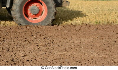 tractor in the summer end tillage