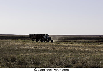 Tractor is on the agricultural field