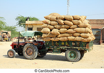 tractor loaded with bags in india