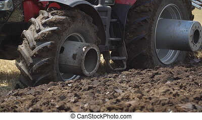 tractor mounted plow - plow attached to the tractor, close-...