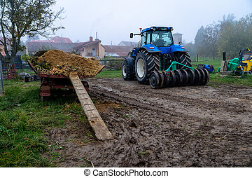 tractor on a farm in the countryside
