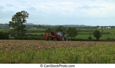 Tractor on Crop Soil - Steady, wide shot of a tractor on ...
