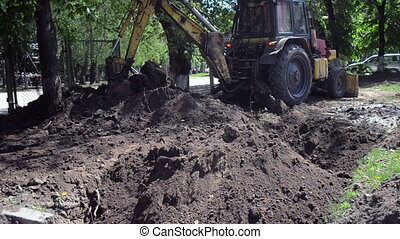 Old tractor in maintenance work. - Tractor pits the ground....