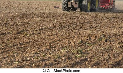 Tractor plant crops with special sow tool. Closeup. 4K -...