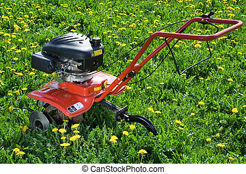 Tractor plough from back side on the flowering field