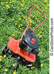 Tractor plough from front side on the flowering field