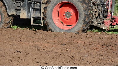 tractor plough soil - closeup of heavy agricultural machine...