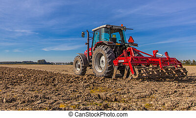 Tractor ploughing field - Field being ploughed by tractor...