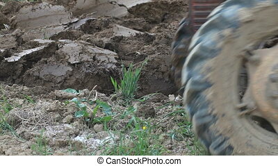 Tractor Ploughing in the Field - Cultivating Soil with...