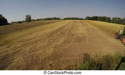 Tractor ploughing soil in the field