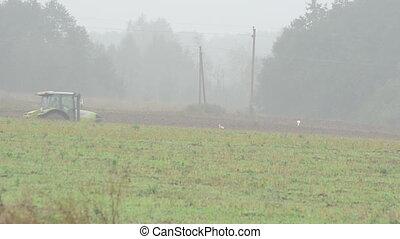 tractor plow field fog