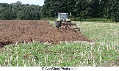 tractor plowed autumn field