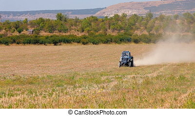 Tractor plowed wheat field