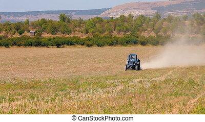 Tractor plowed wheat field