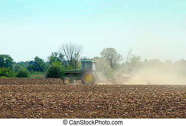 Tractor Plowing a field on a spring day