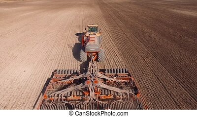 Tractor plowing - aerial shot