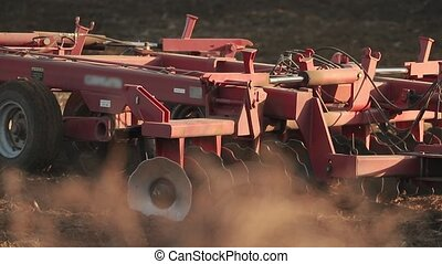 Tractor plowing agricultural land, slow motion from 120 fps footage